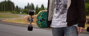 how to carry a longboard