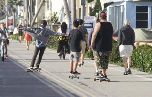 longboard cruising on the san diego boardwalk