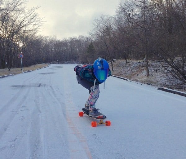 longboarding on snow-covered roads