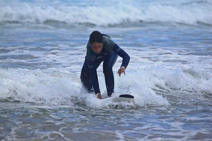 learning to surf on a shortboard
