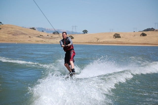 Is riding a wakeboard behind the boat easy?