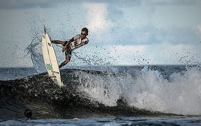 Slashing on a surfboard with the Typhoons