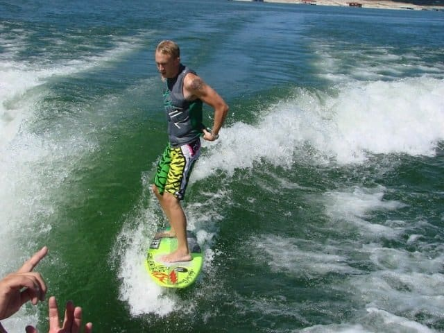 wakesurfing involves riding close to the boat